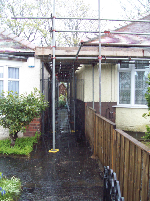 Scaffold erected on Clients property - one of the causes of the party wall dispute